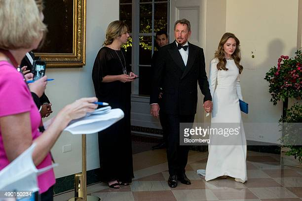 Billionaire Larry Ellison executive chairman and chief technology officer of Oracle Corp left and Nikita Kahn arrive at a state dinner in honor of...