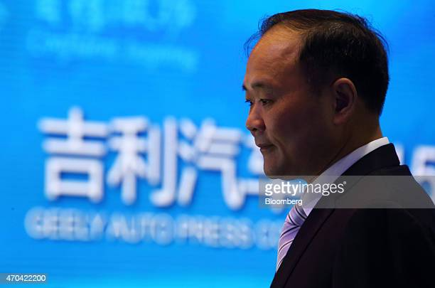 Billionaire Li Shufu founder and chairman of Geely Automobile Holdings Ltd left attends a news conference at the 16th Shanghai International...