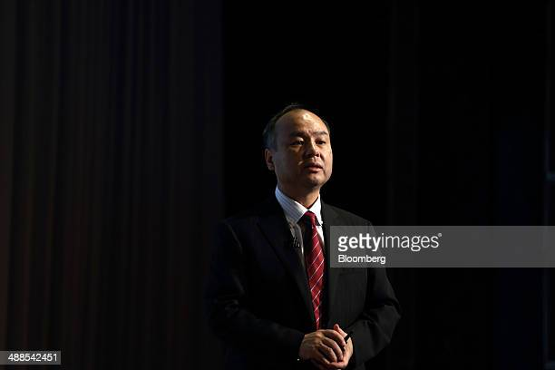 Billionaire Masayoshi Son chairman and chief executive officer of SoftBank Corp speaks during a news conference in Tokyo Japan on Wednesday May 7...