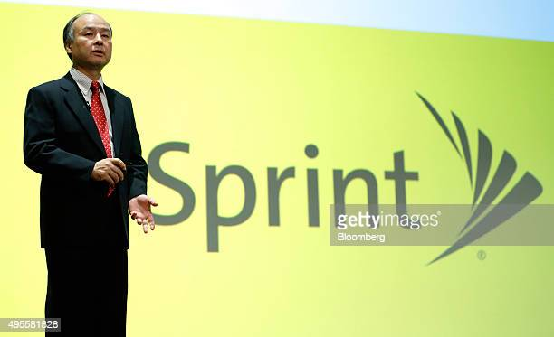 Billionaire Masayoshi Son chairman and chief executive officer of SoftBank Group Corp speaks in front of a Sprint Corp logo during a news conference...