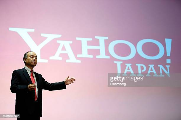 Billionaire Masayoshi Son chairman and chief executive officer of SoftBank Group Corp gestures in front of a Yahoo Japan logo during a news...