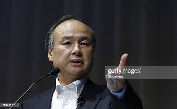 Billionaire Masayoshi Son chairman and chief executive officer of SoftBank Group Corp gestures as he speaks during a news conference in Tokyo Japan...