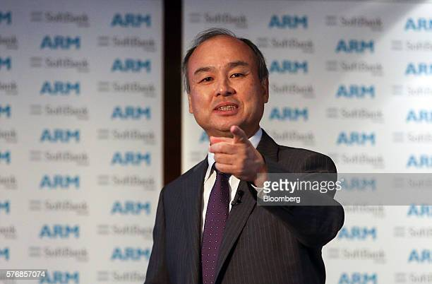 Billionaire Masayoshi Son chairman and chief executive officer of SoftBank Group Corp gestures whilst speaking during a news conference in London UK...