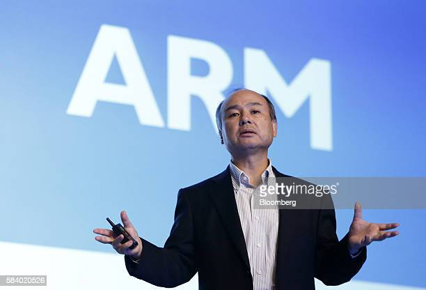 Billionaire Masayoshi Son chairman and chief executive officer of SoftBank Group Corp speaks in front of a screen displaying the ARM Holdings Plc...