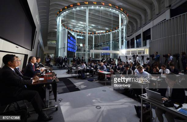 Billionaire Masayoshi Son chairman and chief executive officer of SoftBank Group Corp third from left speaks at a news conference at the Tokyo Stock...