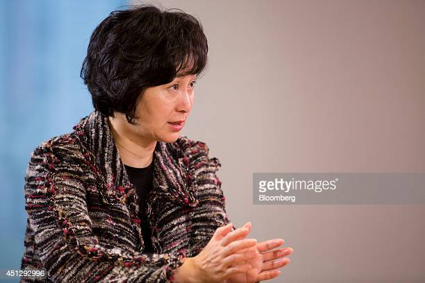 Billionaire Pansy Ho cochairman of MGM China Holdings Ltd gestures as she speaks during an interview in Hong Kong China on Friday March 28 2014 MGM...