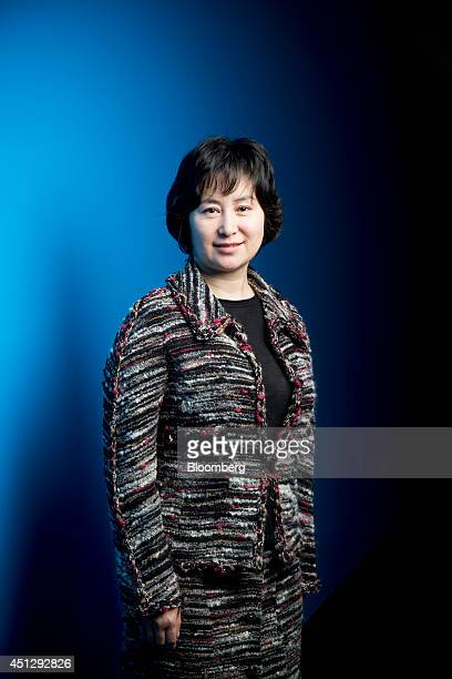 Billionaire Pansy Ho cochairman of MGM China Holdings Ltd poses for a photograph in Hong Kong China on Friday March 28 2014 MGM China of which casino...