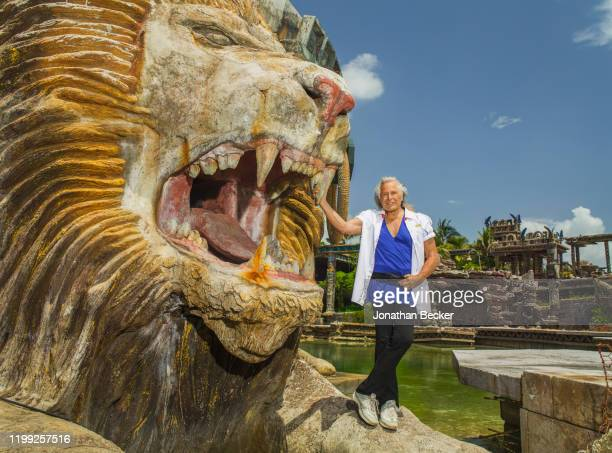 Billionaire Peter Nygard is photographed with one of his oversize lion heads for Vanity Fair Magazine on July 3 2015 at Nygard Cay in Lyford Cay...