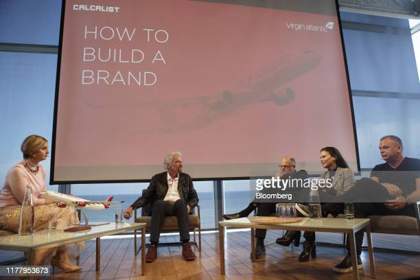 Billionaire Richard Branson founder and president of Virgin Atlantic Airways Ltd center speaks on a panel with Gil Shwed chief executive officer of...