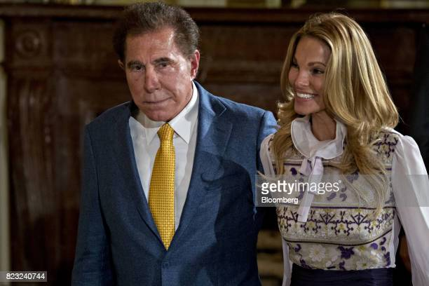 Billionaire Steve Wynn chairman and chief executive officer of Wynn Resorts Ltd left and wife Andrea Hissom arrive to an event in the East Room of...