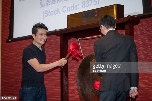 Billionaire Tan Min-Liang, chief executive officer and co-founder of Razer Inc., left, and Lim Kaling, non-executive director, strike a gong during...