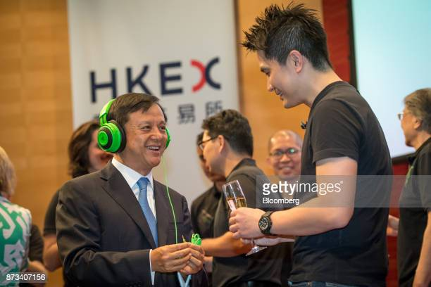 Billionaire Tan Min-Liang, chief executive officer and co-founder of Razer Inc., right, speaks to Charles Li, chief executive officer of Hong Kong...