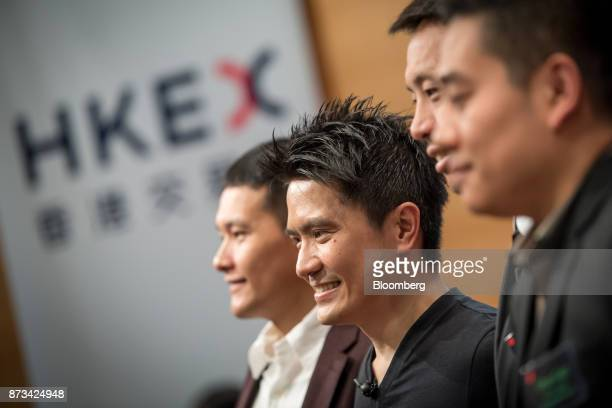 Billionaire Tan Min-Liang, chief executive officer and co-founder of Razer Inc., second left, stands for photographs during the company's listing...