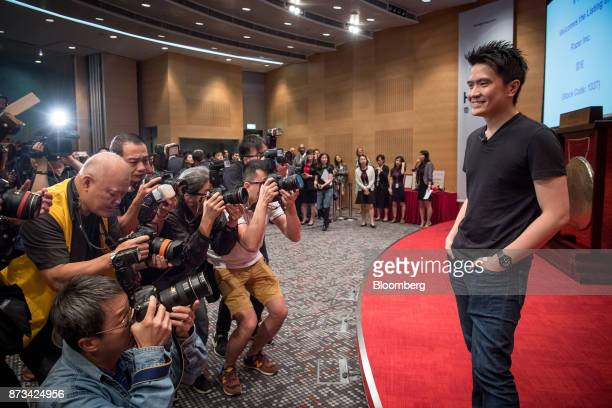 Billionaire Tan MinLiang chief executive officer and cofounder of Razer Inc right stands for photographs for members of the media during the...