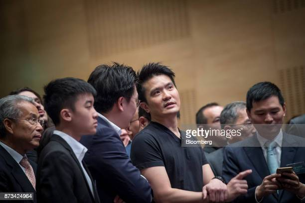 Billionaire Tan Min-Liang, chief executive officer and co-founder of Razer Inc., center, speaks with attendees during the company's listing ceremony...