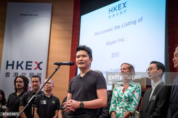 Billionaire Tan Min-Liang, chief executive officer and co-founder of Razer Inc., center, speaks during the company's listing ceremony at the Hong...