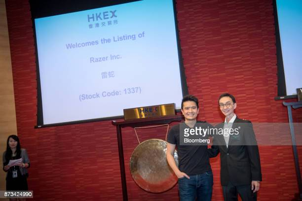 Billionaire Tan Min-Liang, chief executive officer and co-founder of Razer Inc., left, and Lim Kaling, non-executive director, pose for photographs...