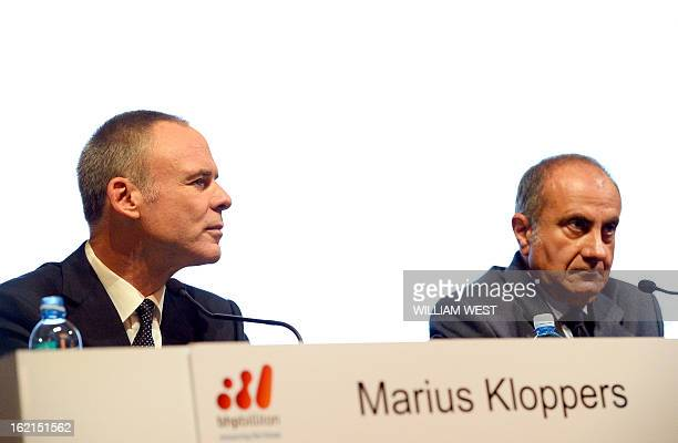 BHP Billiton CEO Marius Kloppers speaks as company chairman Jac Nasser listens as it is announced Kloppers is retiring and will be replaced by Andrew...
