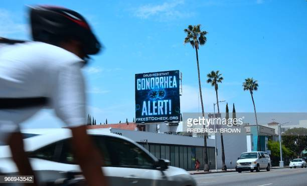 A billoard from the AIDS Healthcare Foundation is seen on Sunset Boulevard in Hollywood California on May 29 2018 warning of a drug resistant...