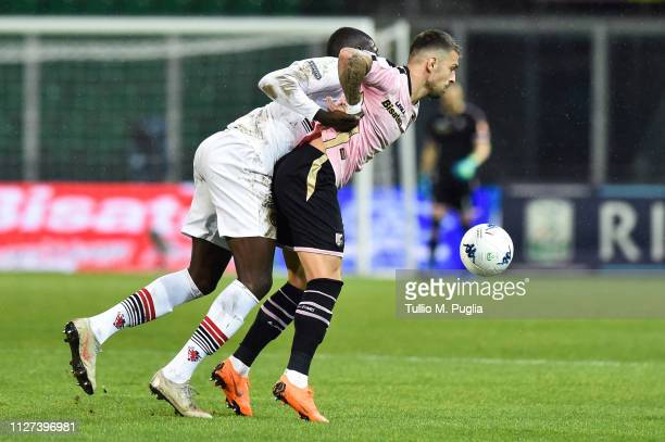 Billong Jean Claude of Foggia and Aleksandar Trajkovski of Palermo compete for the ball during the Serie B match between US Citta di Palermo and...