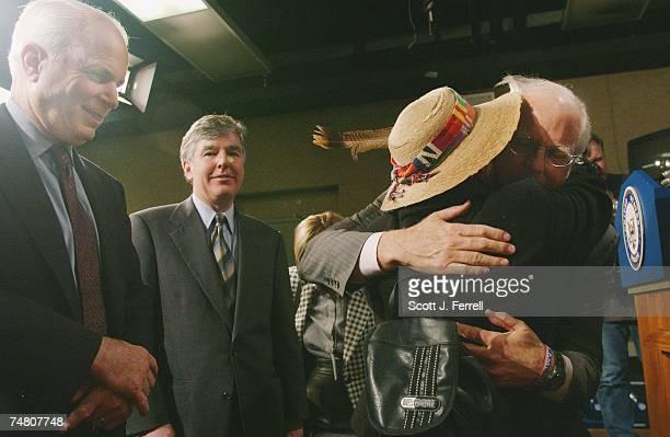 BILLSen John McCain RAriz left and US Rep Martin T Meehan DMass look on as US Rep Christopher Shays RConn hugs campaign finance reform activist...