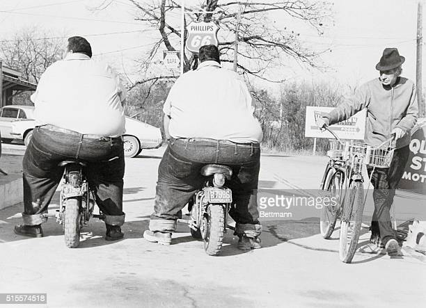 Billy and Benny McCrary stop to put air in their tires at a service station in their hometown of Hendersonville The twins who are billed as the...