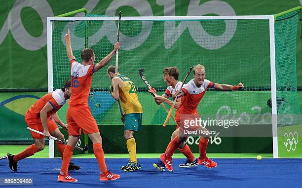 Billy Bakker of the Netherlands celebrates after scoring his second goal during the Men's hockey quarter final match between the Netherlands and...