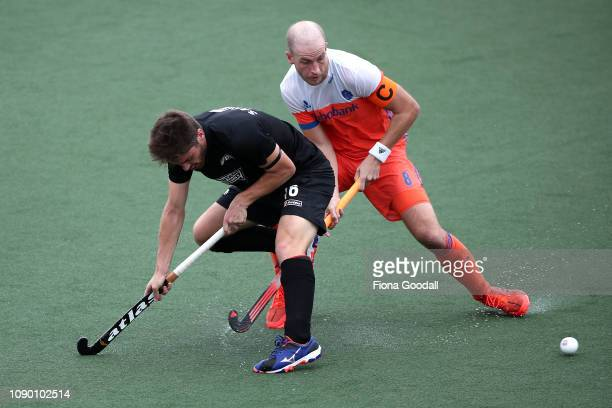 Billy Bakker of the Netherlands tackles Aidan Sarikaya of New Zealand during the Men's FIH Field Hockey Pro League match between New Zealand and...