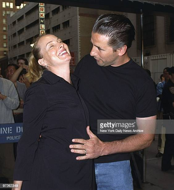 Billy Baldwin hugs pregnant wife Chynna Phillips as they arrive at Madison Square Garden to see the first of Madonna's five Drowned World Tour...