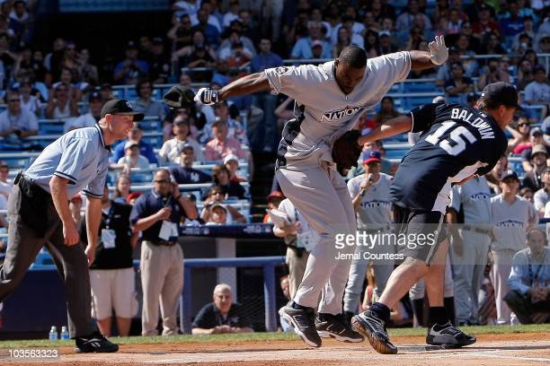 Billy Baldwin tags out Justin Tuck at home during the 2008 MLB All-Star Week Taco Bell All-Star Legends & Celebrity Softball Game at Yankee Stadium...