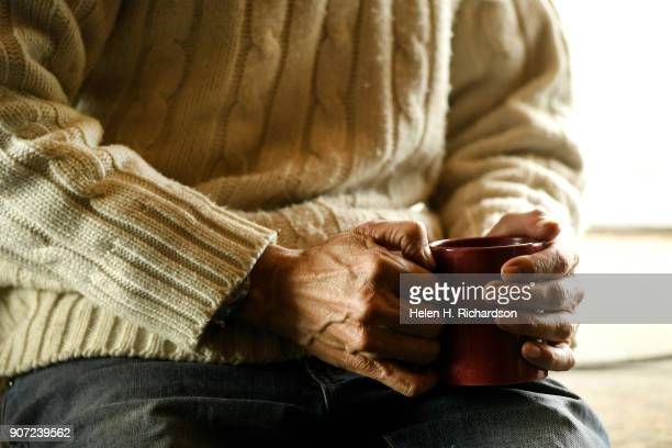billy barr chats as he enjoys a cup of tea at his remote cabin on January 9 2018 in Gothic Colorado barr who is a reclusive mountain man and who...