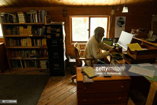 billy barr checks his computer while making making daily updates in his notebooks at his remote cabin on January 9 2018 in Gothic Colorado barr who...