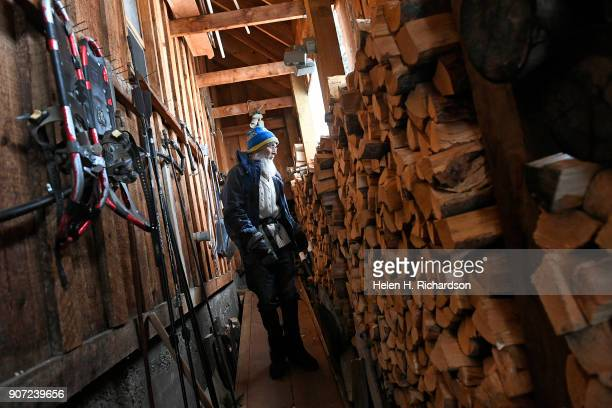 billy barr heads out of his remote cabin past a 2 year supply of firewood on January 9 2018 in Gothic Colorado barr who is a reclusive mountain man...
