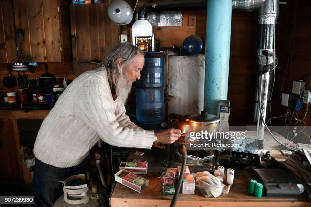 billy barr lights his stove to make some tea at his remote cabin on January 9 2018 in Gothic Colorado barr who is a reclusive mountain man and who...