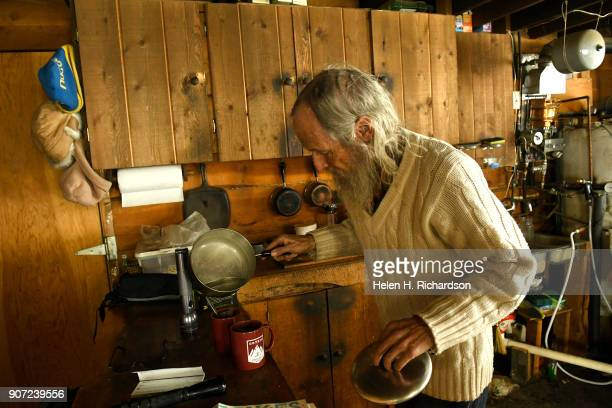 billy barr makes some tea at his remote cabin on January 9 2018 in Gothic Colorado barr who is a reclusive mountain man and who prefers having his...