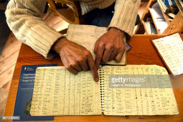 billy barr points to some data in one of his many notebooks from April 2005 that is filled with handwritten and hand gathered information by billy...