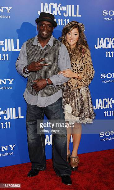 Billy Blanks and Tomoko Sato arrive for the Los Angeles premiere of Jack And Jill at Regency Village Theatre on November 6 2011 in Westwood California