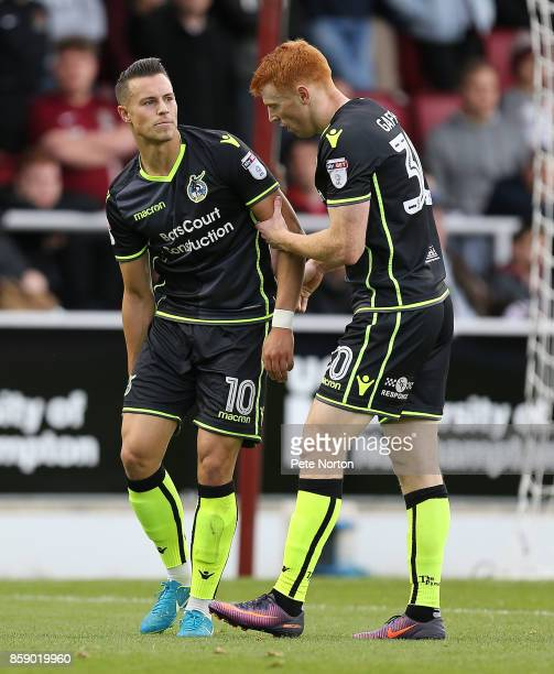 Billy Bodin of Bristol Rovers is congratulated by Rory Gaffney after scoring his sides first goal during the Sky Bet League One match between...