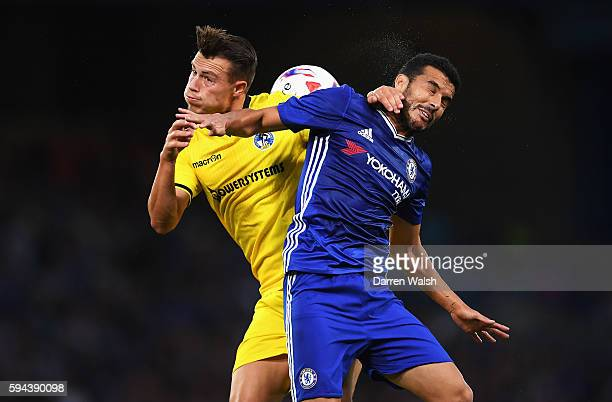 Billy Bodin of Bristol Rovers jumps for a header with Pedro of Chelsea during the EFL Cup second round match between Chelsea and Bristol Rovers at...