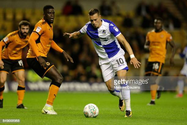 Billy Bodin of Bristol Rovers shoots at goal ahead of Alfred N'Diaye of Wolverhampton Wanderers during the Carabao Cup tie between Wolverhampton...