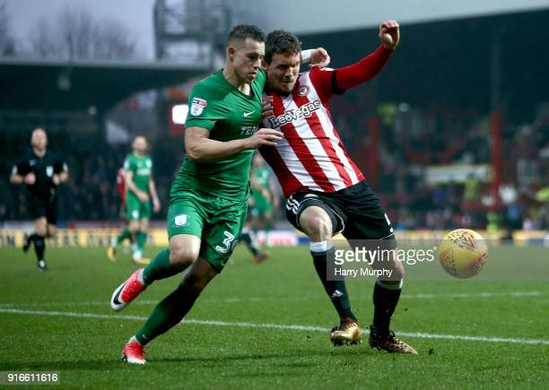 Billy Bodin of Preston North End battles for possession with Andreas Bjelland of Brentford during the Sky Bet Championship match between Brentford...