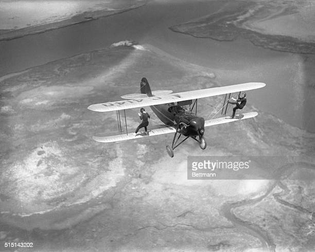 Billy Bomar and Uva Kimmey of the Howard Flying Circus are just out for a stroll doing a little wingwalking on the Waco plane in flight over Barren...
