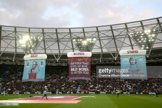 Billy Bonds flags hang in The London Stadium in front of the stand newly named after him during the Premier League match between West Ham United and...