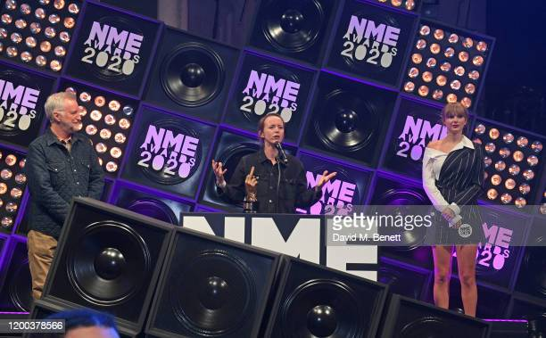 Billy Bragg Emily Eavis winner of the Godlike Genius award and Taylor Swift attend The NME Awards 2020 at the O2 Academy Brixton on February 12 2020...