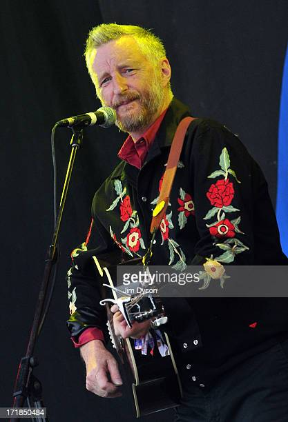 Billy Bragg performs on the Pyramid stage during day 3 of the 2013 Glastonbury Festival at Worthy Farm on June 29 2013 in Glastonbury England