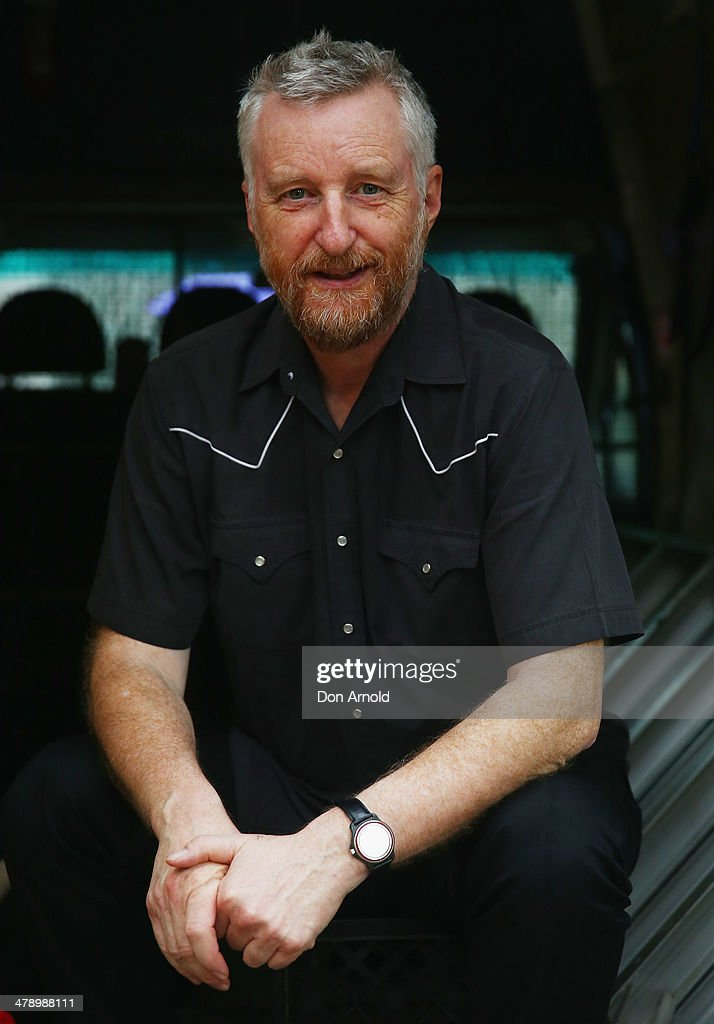 Billy Bragg poses inside a van in Belmore Park during a protest demonstration against the Abbott led Coalition Government on March 16, 2014 in Sydney, Australia. March In March is a nationwide grassroots protest organized to deliver a statement of no confidence in the current Australian Government.