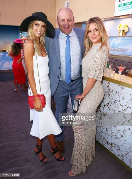 Billy Brownless and daughters Lucy Brownless and Ruby Brownless pose at the Emirates Marquee on Stakes Day at Flemington Racecourse on November 11...