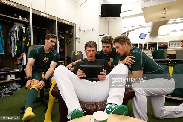 Billy Burns Chris Bassitt Josh Phegley and Kendall Graveman of the Oakland Athletics watch a video in the clubhouse prior to the game against the Los...