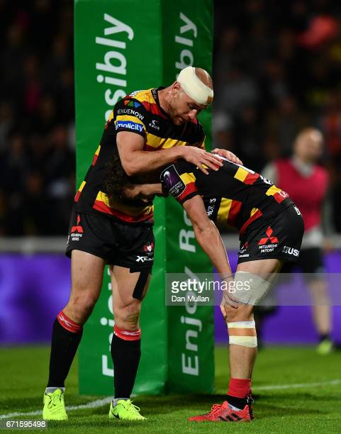 Billy Burns of Gloucester is congratulated by Willi Heinz of Gloucester after scoring a breakaway try during the European Rugby Challenge Cup Semi...