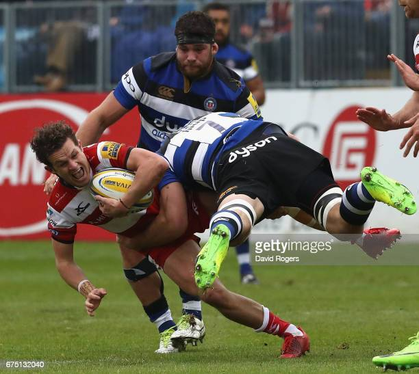 Billy Burns of Gloucester is tackled by Francois Louw during the Aviva Premiership match between Bath and Gloucester at the Recreation Ground on...